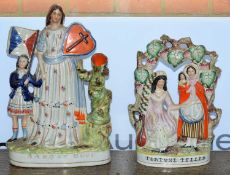 Two Staffordshire pottery flatback pottery figures one titled 'Land of hope' 35cm high, the other '