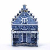 Delft blue and white model house Dutch, marked to the veranda 'IN'T MAKKUMERHUIS', 18cm high x