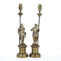 Pair of brass table lamps each in the form of a medieval figure on a plinth base, 45cm highCondition