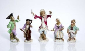 Group of five Meissen 'Monkey band' porcelain figures with blue crossed swords marks and impressed