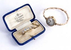 Victorian moonstone brooch on yellow precious metal mounts, unmarked, 4g approx, and a 9ct gold