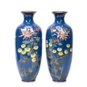 Pair of Japanese cloisonne enamel vases with bird amongst foliage designs on blue ground, 37cm