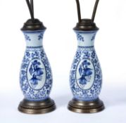 Pair of Delft pottery lamp bases with brass mounts, 53cm (excluding shades)Condition report: Light
