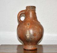 Salt-glazed stoneware bellarmine circa 1600, with masked head impressed to the neck 22.5cm