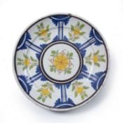 Delft dish with powder blue ground Dutch ca.1720 with reserves containing polychrome birds, 29.5cm