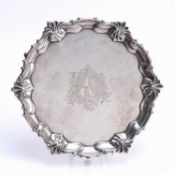 Matched pair of silver trays one a George IV silver tray, with shaped edges standing on three pad