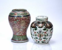 Two Chinese vases 18th/19th Century, to include a coral red ground baluster vase with foliate