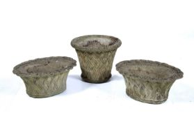 Pair of reconstituted oval basket urns 50cm x 40cm x 23cm and a similar basket weave circular urn,
