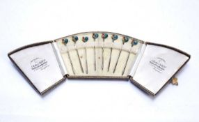 Set of eight silver and enamel stirrers in fitted case, decorated with cockerels, bearing marks