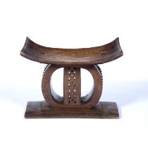 Ashanti stool with carved centre and rectangular base, 54cm x 27cm x 48cmCondition report: Chip to