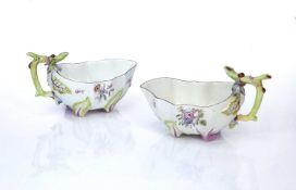 Pair of Chelsea strawberry sauceboats circa 1755, both modelled with twig handles, painted to the