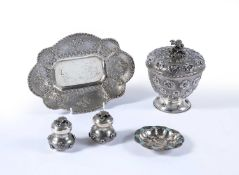 Group of white metal including a covered vase, embossed with flower heads15.5cm high, a pair of