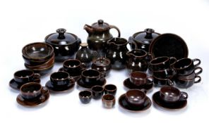 Collection of Winchcombe pottery to include tureens with covers, coffee cups and saucers, jugs etc