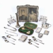 Collection of silver to include: toast racks, vesta case, condiment pot with blue glass liner,