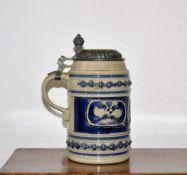 Westerwald saltglazed tankard 19th Century, with spread eagle design and hinged tin lid 19.5cm