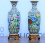 Pair of white cloisonne enamel vases 20th Century, with floral decoration on open fret carved wooden