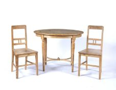Pine oval table with shaped stretcher, 103cm x 73cm x 78cm high and a pair of pine similar chairs,