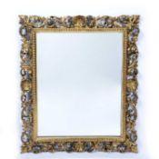 Florentine gilt wood wall mirror Italian, with foliate and shell border, 78cm x 70cm