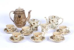 A late 19th Century Japanese pottery part tea service, painted and gilt decorated with insects,