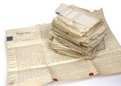 A bundle of 18th/19th century manuscript vellum/parchment deeds, conveyances etc (c40)