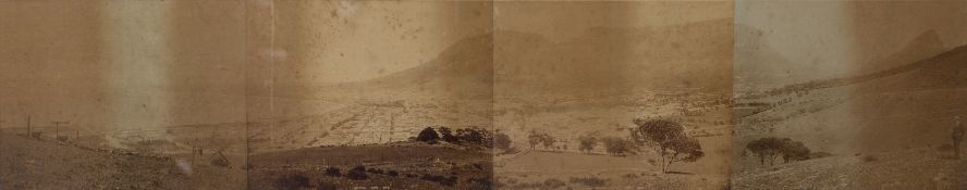 A panoramic framed photograph view of Cape Town c1900, four images glued down and framed, 112 x
