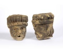 Two early English carved limestone corbel heads, possibly window arch supports both with open