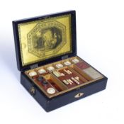 A 19th century leather sewing box, the fully fitted interior with metal studded divisions, and