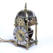 A late 17th century brass lantern clock, the applied silvered roman chapter ring with trident half