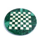 A Malachite circular chessboard, with gilt wire strung border and white onyx chequers, 24.3cm