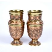 A pair of late 19th century Arts & Crafts copper and brass vases, of heavy gauge, each of baluster