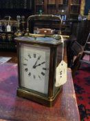 A French brass repeater carriage clock with white enamel dial, 14cm high