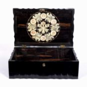 An Oriental ebonized hardwood box, carved fluted shaped sides and the inside lid decorated with