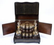 A late 19th century French gilded glass liqueur set, sixteen small baluster glasses and four