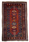 A Kasak polychrome rug with six central hooked medallions within a multiple border, 253 x 156cm