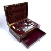 A mid 19th century mahogany and brass bound campaign travelling box, the fully fitted interior