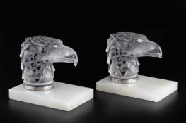 René Lalique (1860-1945) A pair of Tete D'Aigle car mascots, circa 1930, frosted glass on