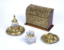 A late 19th Century brass mounted oak stationery box, embossed with stylised sinuous foliage, and