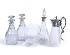 A pair of 19th century mallett shaped glass decanters and stoppers, 26cm high; a cut glass
