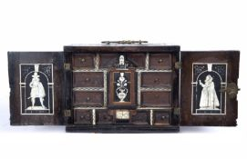 A 17th century and later Continental miniature table cabinet, the pair of doors, top and sides all