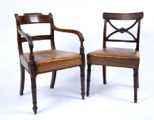 A set of six George III mahogany dining chairs each with an 'X' frame back, studded and