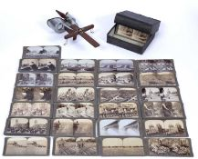 A Stereograph viewer by Underwood & Underwood, together with a large quantity of photo stereoview