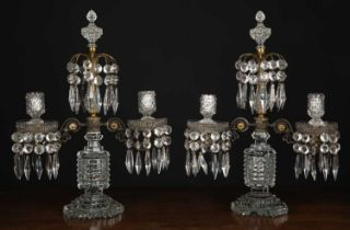 A pair of two branch cut glass Regency-style candelabras, the two branches and central raised finial