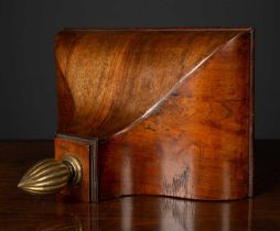 A 19th century walnut clock wall bracket with ogee form with brass finial, 28.5cm wide x 17.5cm deep