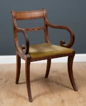 A Regency mahogany carver armchair with bar back and reeded ornament to the arms and sabre legs,