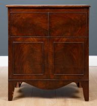 A George III mahogany commode cabinet or chest with lifting hinge lid and turned cover to the seat