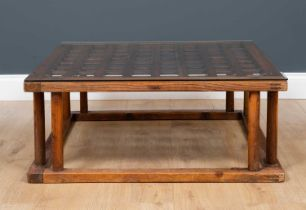 An old Japanese elm kotatsu table with turned support and later glass top, 79.5cm square to the