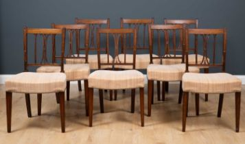 A set of twelve early George III mahogany dining chairs with satinwood banded top rails, the