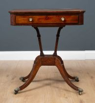 A George III mahogany reading table the rectangular tilting top with canted corners and ebony