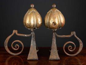 A pair of Victorian brass and steel art nouveau andirons the finials in the form of stylised seed