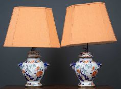 A pair of table lamps set with 19th century 'Stone China' vases and covers, with dolphin masks and